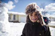 Boy, child standing in a snowy suburban environment. - MINF05131
