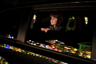 Boy, child leaning out of a car window looking at Christmas lights. - MINF05140