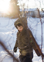 Boy, child wearing a coat and standing in the snow. - MINF05268