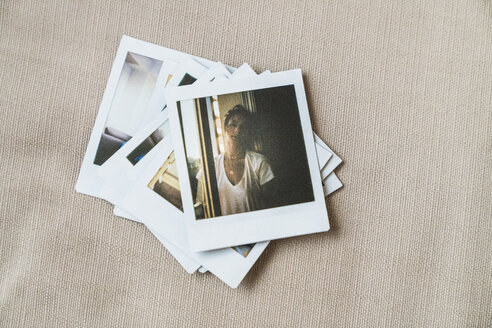 Stack of instant photos of young woman - KKAF01450