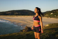 Sportive woman enjoying sunset light - RAEF02065