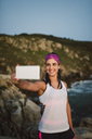 Athlete woman taking a selfie on the coast in the evening - RAEF02089