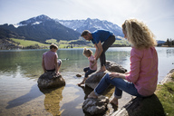Austria, Tyrol, Walchsee, happy family at the lake - JLOF00150
