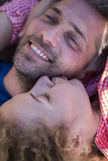 Happy affectionate couple lying down - JLOF00168