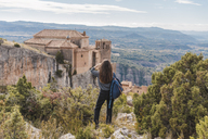 Spain, Alquezar, back view of young woman looking at view - AFVF01302