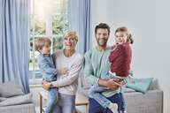 Portrait of happy family with two kids at home - RORF01384