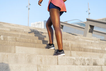 Young woman during workout on stairs, climbing stairs - AFVF01315