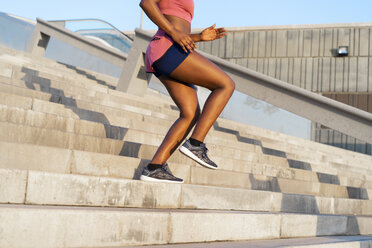 Young woman during workout on stairs - AFVF01318