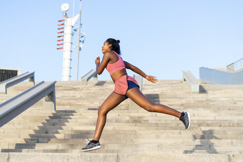 Young woman during workout on stairs - AFVF01324