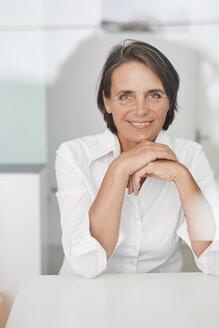 Portrait of mature businesswoman wearing white blouse - PNEF00852