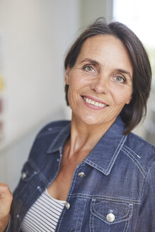 Portrait of smiling mature woman wearing denim shirt - PNEF00861