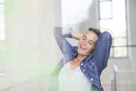 Portrait of smiling mature woman wearing denim shirt - PNEF00864