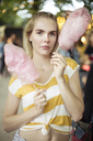 Portrait of young woman with pink candy floss on streetfood festival - JESF00005