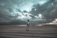 Spaceman standing alone at lake on nameless planet - VPIF00459