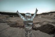 Spaceman raising arms on a nameless planet, with thumbs up - VPIF00501