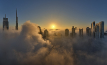 View of the Burj Khalifa and other skyscrapers above the clouds in Dubai, United Arab Emirates. - MINF06514