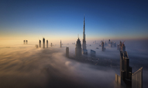 View of the Burj Khalifa and other skyscrapers above the clouds in Dubai, United Arab Emirates. - MINF06517