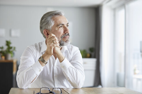 Portrait of pensive mature man  at home - RBF06471