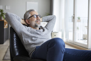 Portrait of mature man relaxing at home - RBF06477