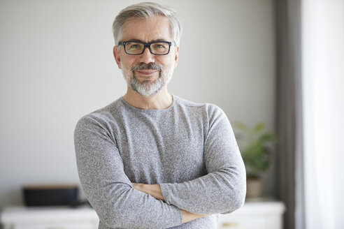 Portrait of content mature man at home - RBF06483