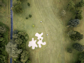 Indonesia, Bali, Aerial view of golf course with bunker and green - KNTF01168