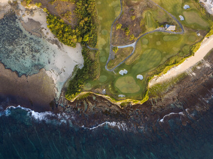 Indonesia, Bali, Aerial view of golf course with bunker and green at coast - KNTF01174