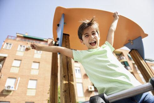 Portrait of happy little girl on playground - JSMF00395