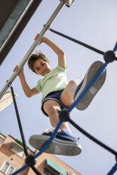Portrait of smiling little girl on jungle gym - JSMF00398