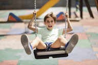 Portrait of little girl having fun on a swing - JSMF00401