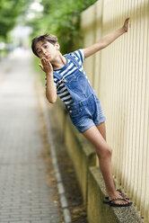 Portrait of little girl blowing a kiss - JSMF00413