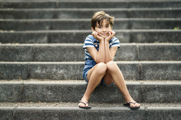 Portrait of relaxed little girl sitting on stairs - JSMF00416
