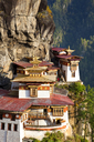High angle view of Himalayan Buddhist sacred site and temple complex perched on a vertical rockface. - MINF06546