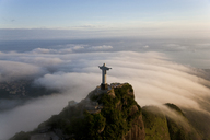 High angle view of colossal Christ Redeemer statue surrounded by clouds, Corcovado, Rio de Janeiro, Brazil. - MINF06549