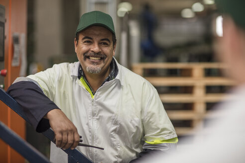 Worker smiling in factory - ZEF15964