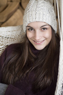 Portrait of smiling young woman wearing wooly hat i - JESF00056