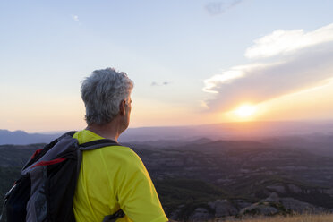 Spain, Catalonia, Montcau, senior man looking at view from top of hill during sunset - AFVF01354