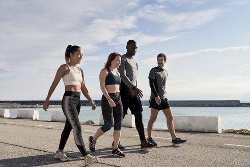 Group of sportspeople walking - JNDF00023