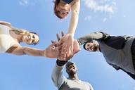 People holding hands together - JNDF00041