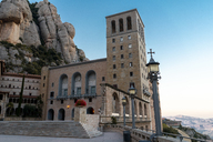 Spain, Catalonia, Montserrat, Santa Maria de Montserrat Abbey in the evening - AFVF01368