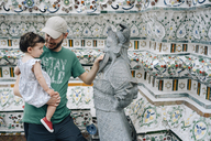Thailand, Bangkok, Wat Arun, Father and daughter visiting the Buddhist temple - GEM02247