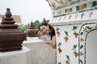 Thailand, Bangkok, Wat Arun, Portrait of happy mother and daughter visiting the Buddhist temple - GEM02250