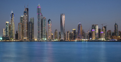 Cityscape of Dubai, United Arab Emirates, with skyscrapers lining the coastline of the Persian Gulf. - MINF07530