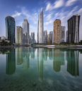 Cityscape of Dubai, United Arab Emirates, with skyscrapers lining the waterfront. - MINF07584