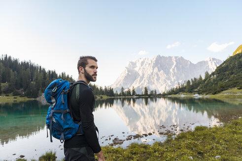 Austria, Tyrol, Hiker with backpack, hiking at Lake Seebensee - DIGF04793
