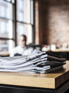 Close-up of files and file folders on a desk top in an office. - MINF07937