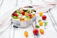 Tortellini salad with tomato, mozzarella and basil in lunch box - LVF07393