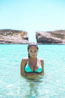 Mlata, Teenage girl wearing bikini, standing in the sea at Comino beach - ACPF00193