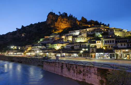 Albania, Berat County, Berat, Mangalem, Ottoman houses and castle rock at blue hour - SIEF07863