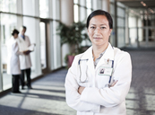 Asian woman doctor in lab coat with stethoscope. - MINF08258