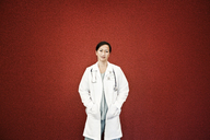 Asian woman doctor in lab coat with stethoscope. - MINF08273
